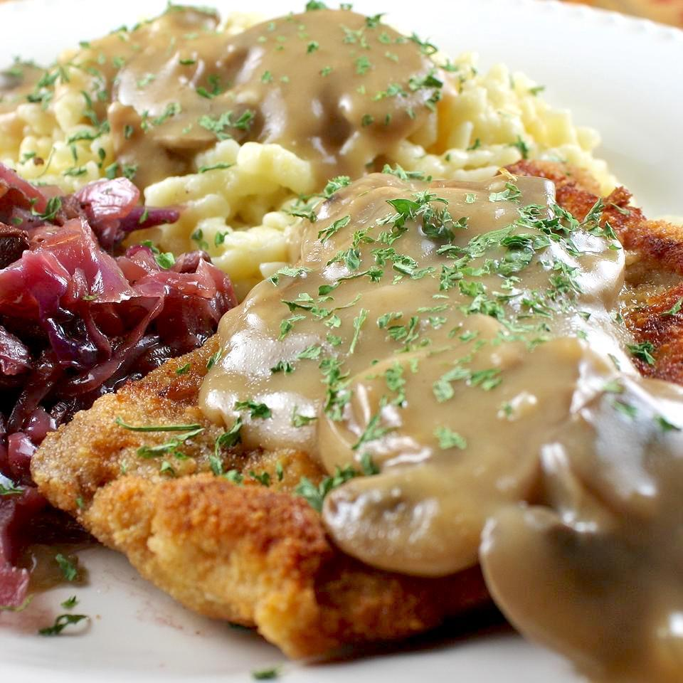 Jaeger Schnitzel with gravy, mashed potatoes, and red cabbage