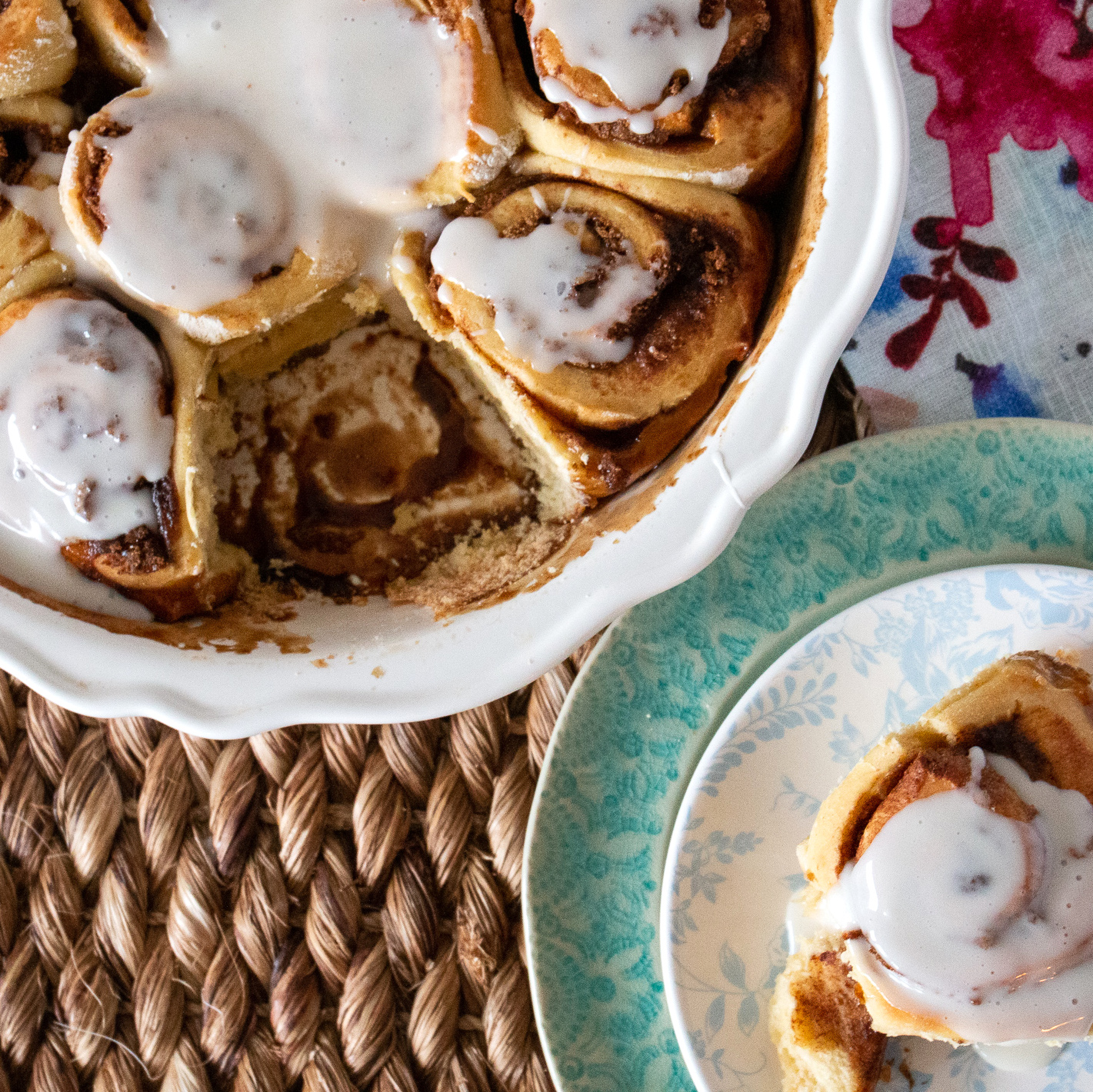 Overnight Cinnamon Rolls I in a dish with one on a plate