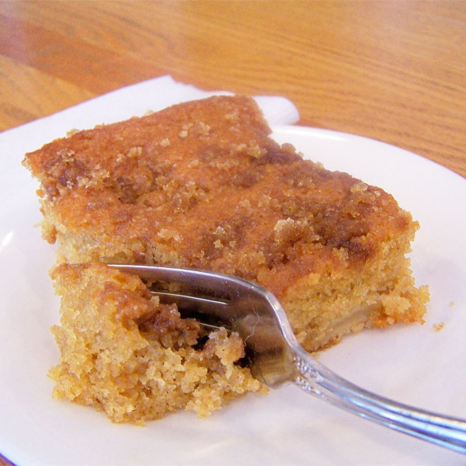 slice of Apple Coffee Cake With Brown Sugar Sauce on a white plate