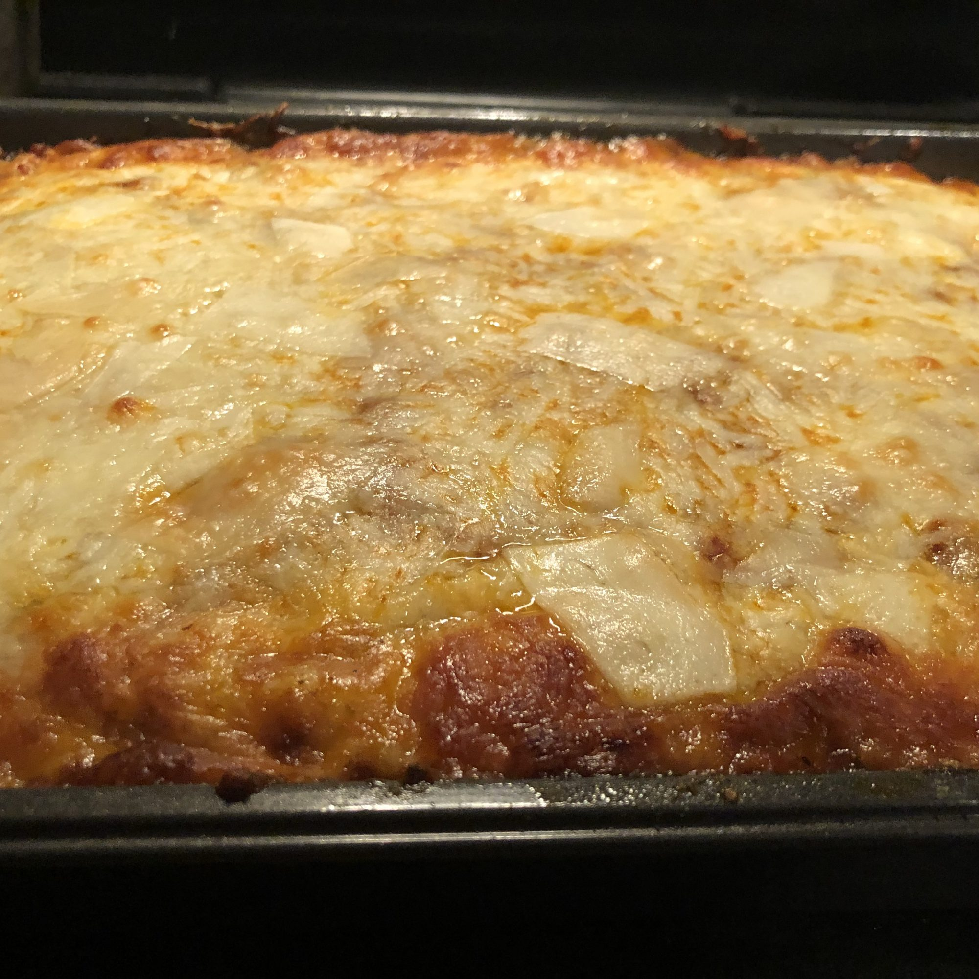 Butternut Squash and Beef Lasagna in a glass pan