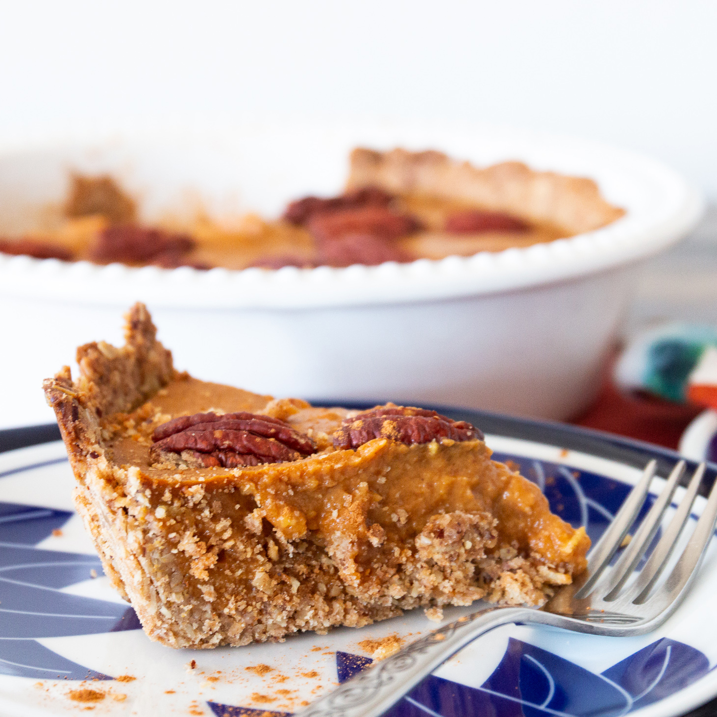 a slice of gluten-free pumpkin pie on a blue and white plate