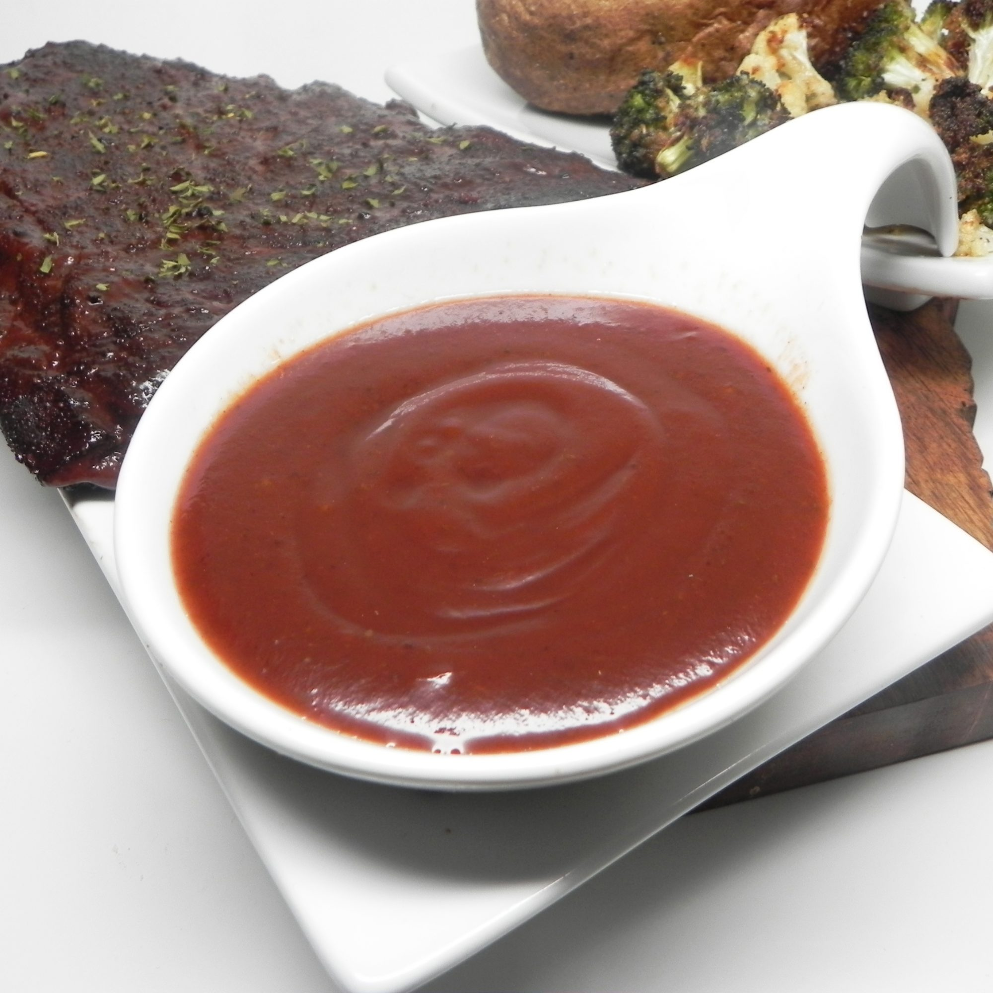 Rockin' Baby Back Ribs Sauce in a white bowl