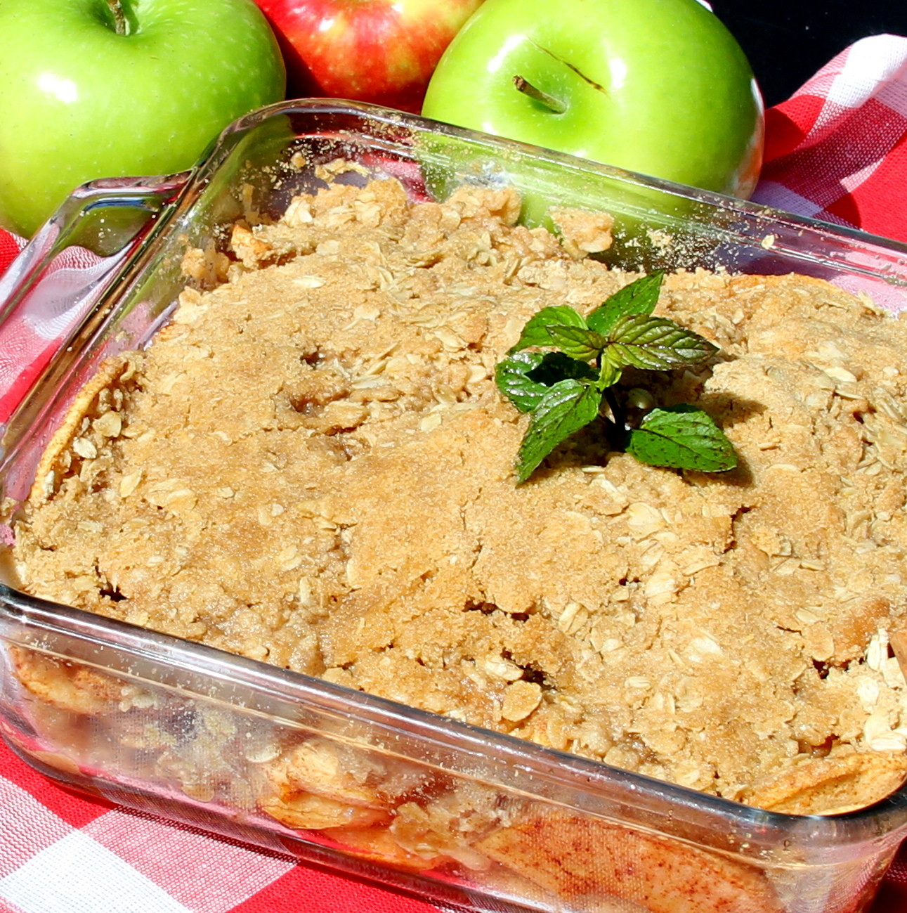 Apple Crisp with Oat Topping in a glass baking dish