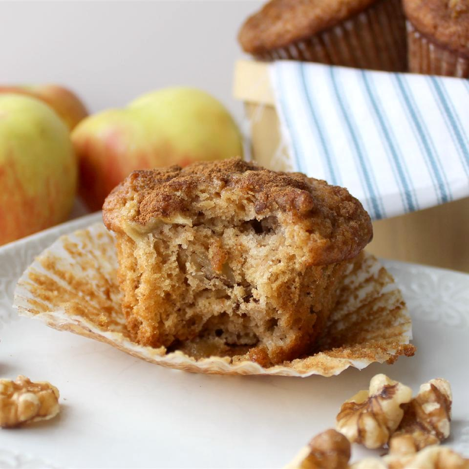 Apple Pie Muffins on a white plate beside apples