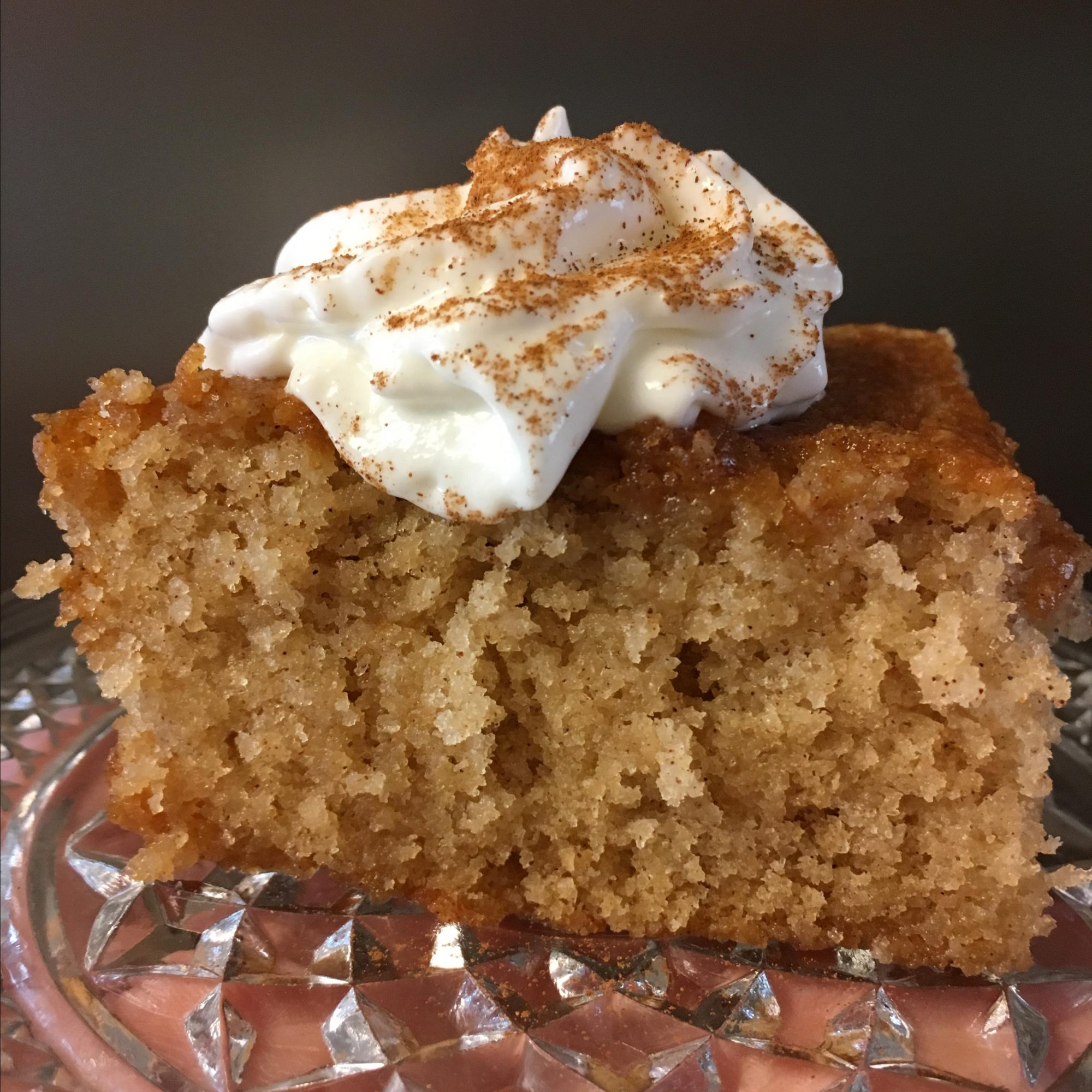Buttery Cinnamon Cake on a glass cake stand