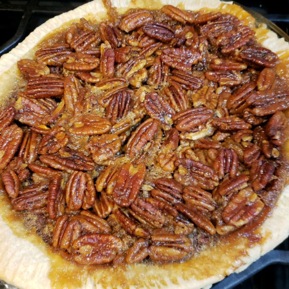 Honey Crunch Pecan Pie with honey butter topping