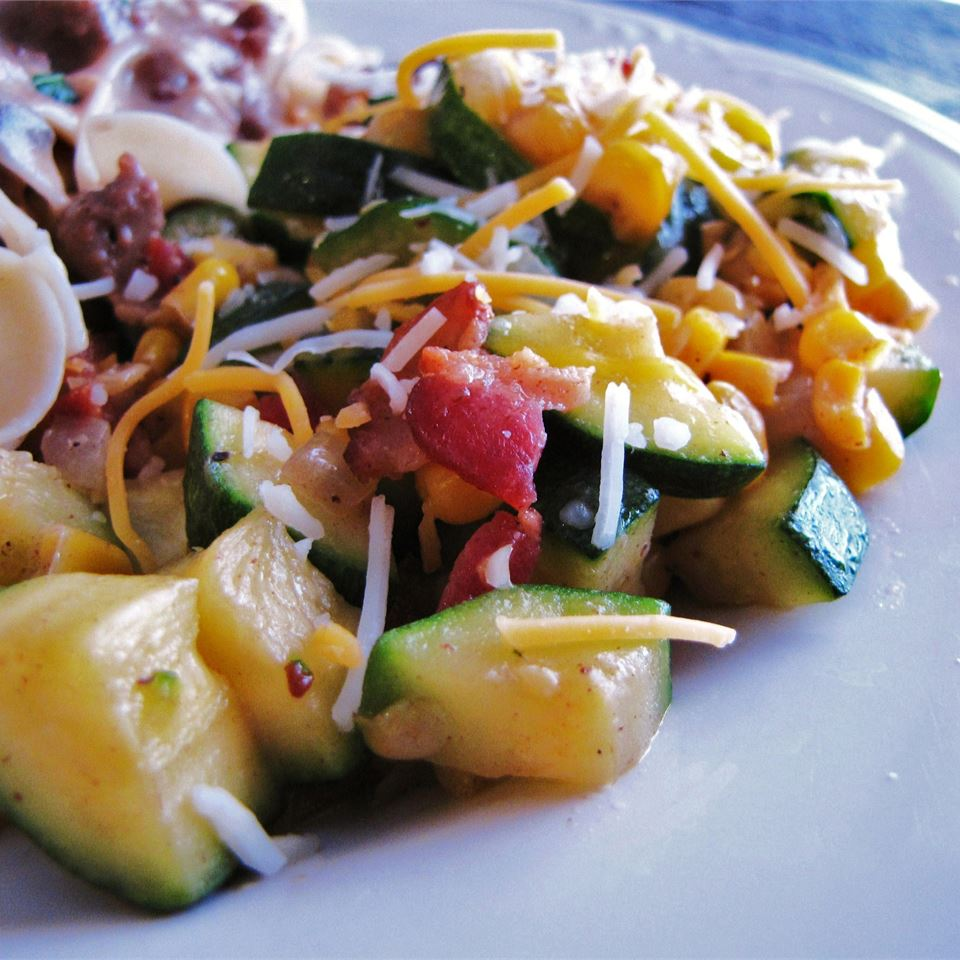 Corn and Zucchini Melody with chopped squash and shredded cheese