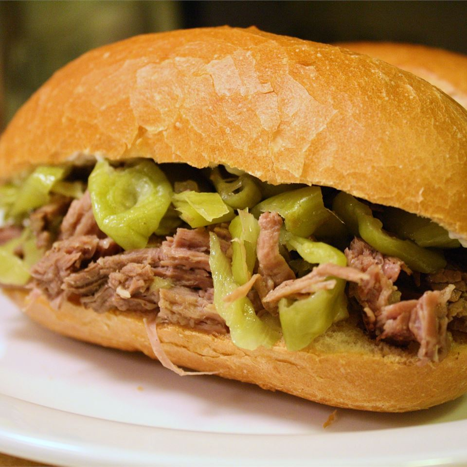 a Pepperoncini Beef sandwich on a white plate