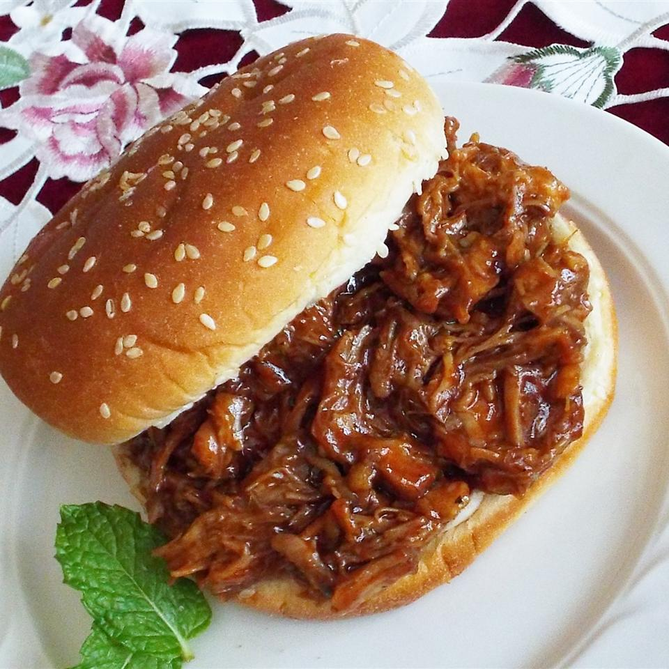 a Slow Cooker Pulled Pork sandwich on a white plate
