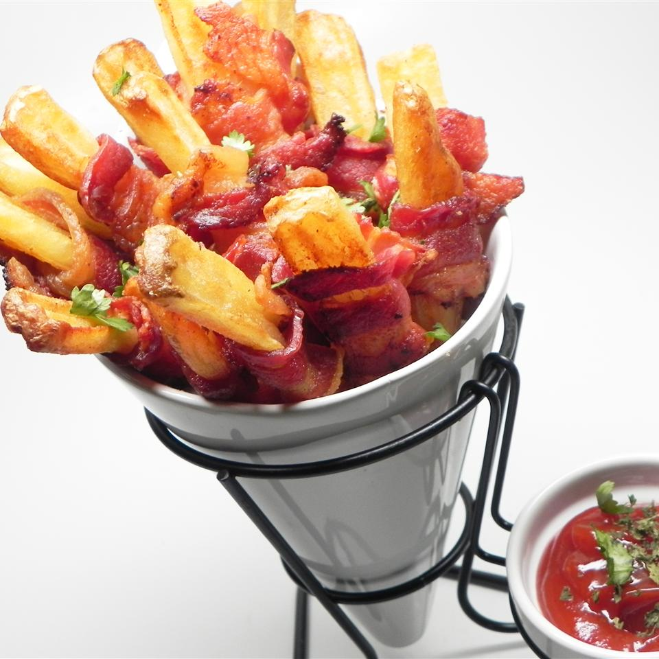 a glass cone of Bacon Fries with a small bowl of ketchup for dipping