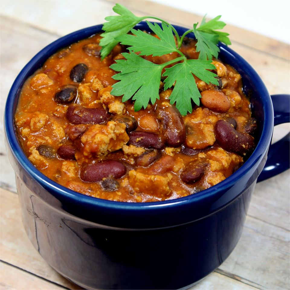 a blue mug holds Laura's Quick Slow Cooker Turkey Chili