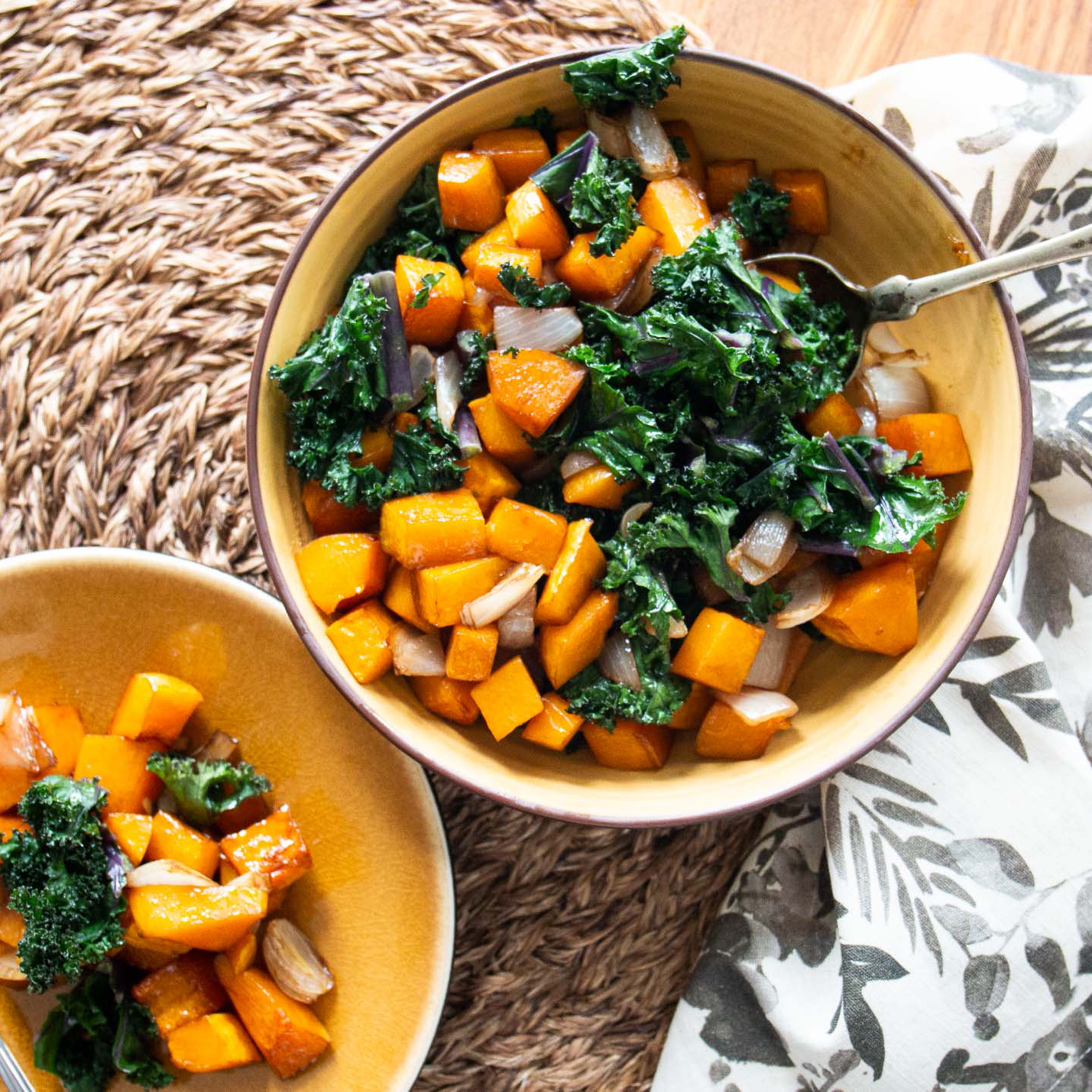 Balsamic Butternut Squash with Kale in two yellow bowls