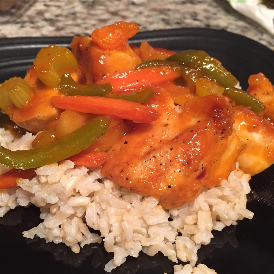Sweet and sour chicken and vegetables over brown rice