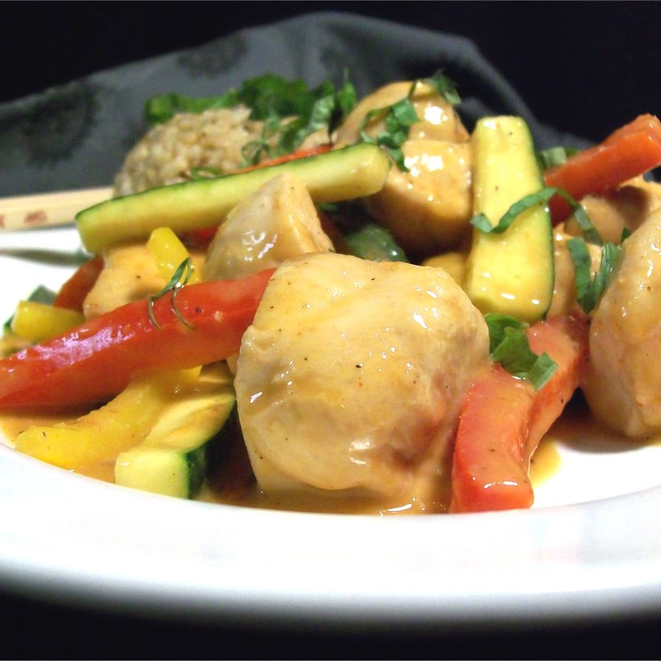 Chicken and vegetable stir fry on white plate