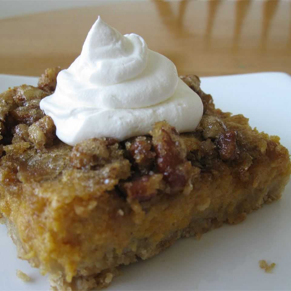Pumpkin Pie Square topped with whipped cream