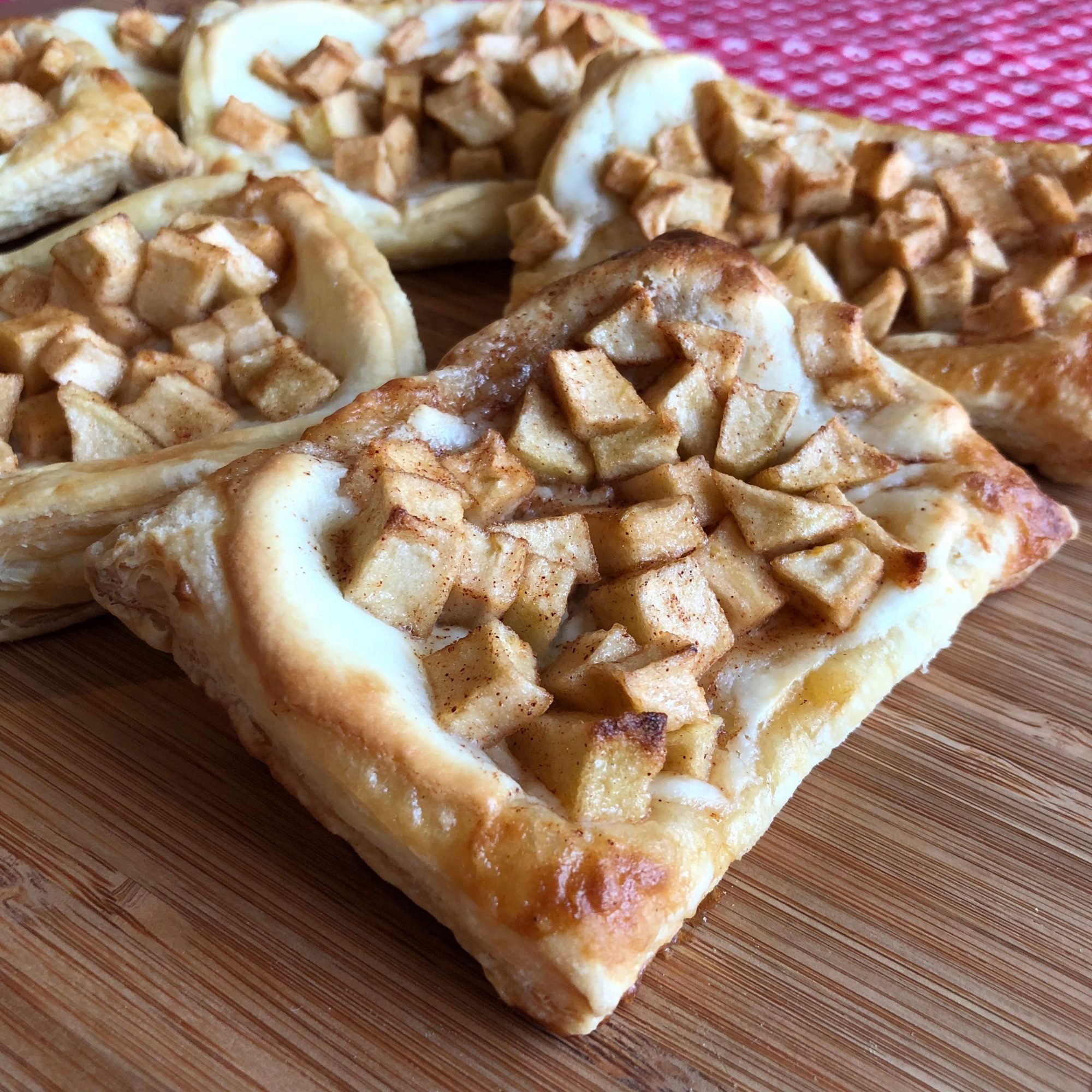 Apple Puff Pastry Tarts on a wooden surface