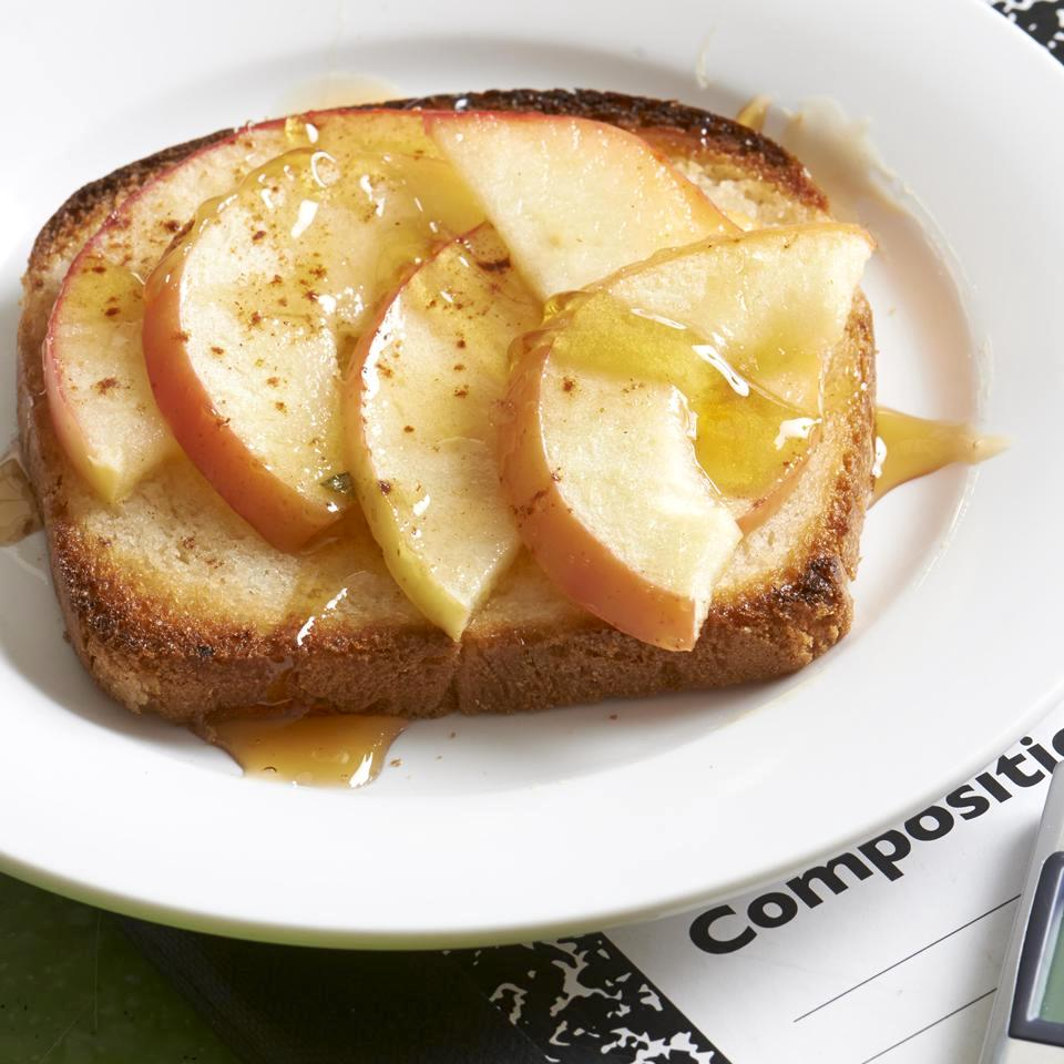 Apple Toast drizzled with honey on a white plate