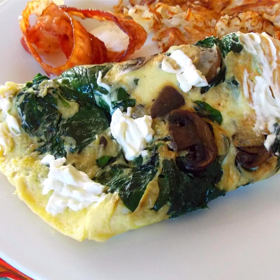 Eggs Florentine with bacon and potato hash