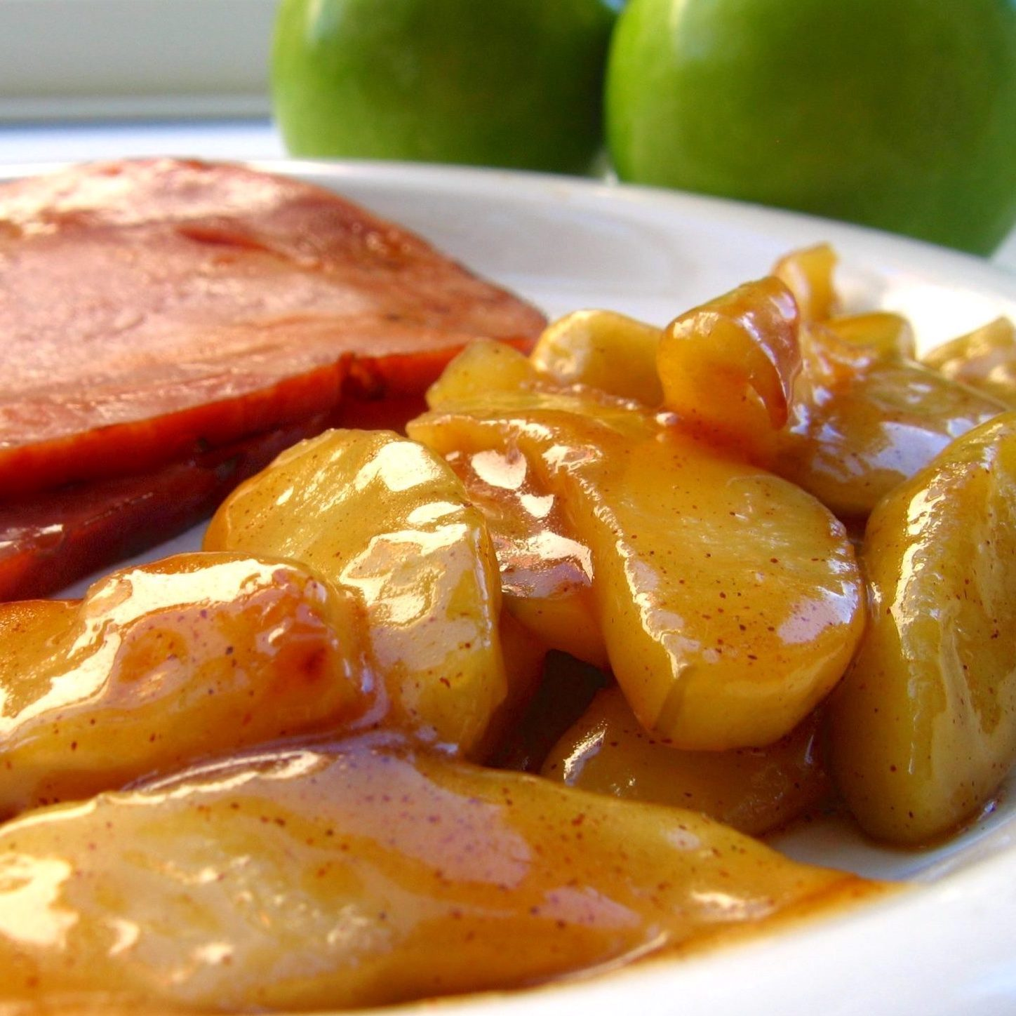 Sauteed Apples on a plate with ham