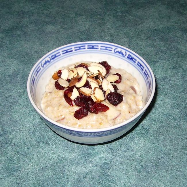 Slow Cooker Fruit, Nuts, and Spice Oatmeal in a white and blue bowl