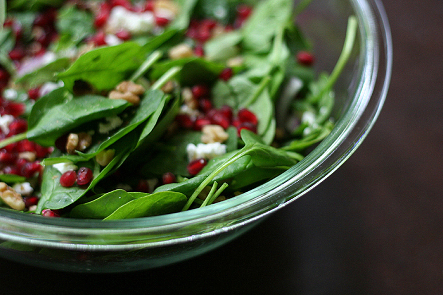 Spinach Pomegranate Salad in clear bowl