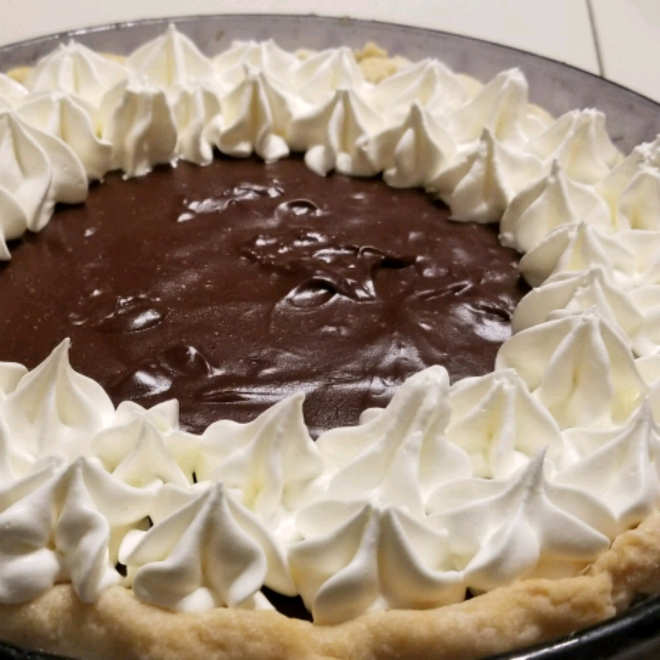 Chocolate Cream Pie decorated with whipped cream