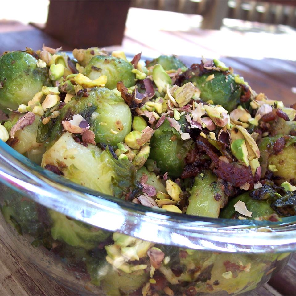 Caramelized Brussels Sprouts with Pistachios in a glass bowl