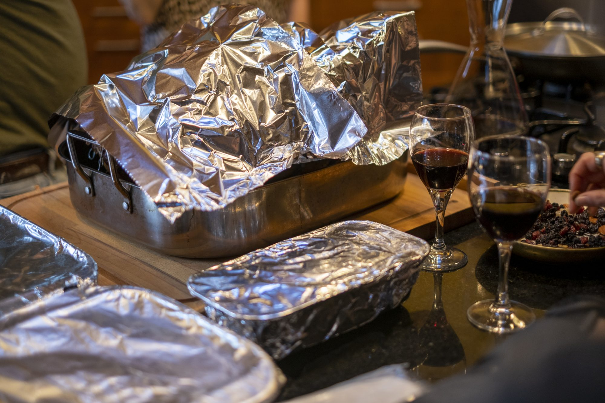 Food dishes on table covered in tin foil