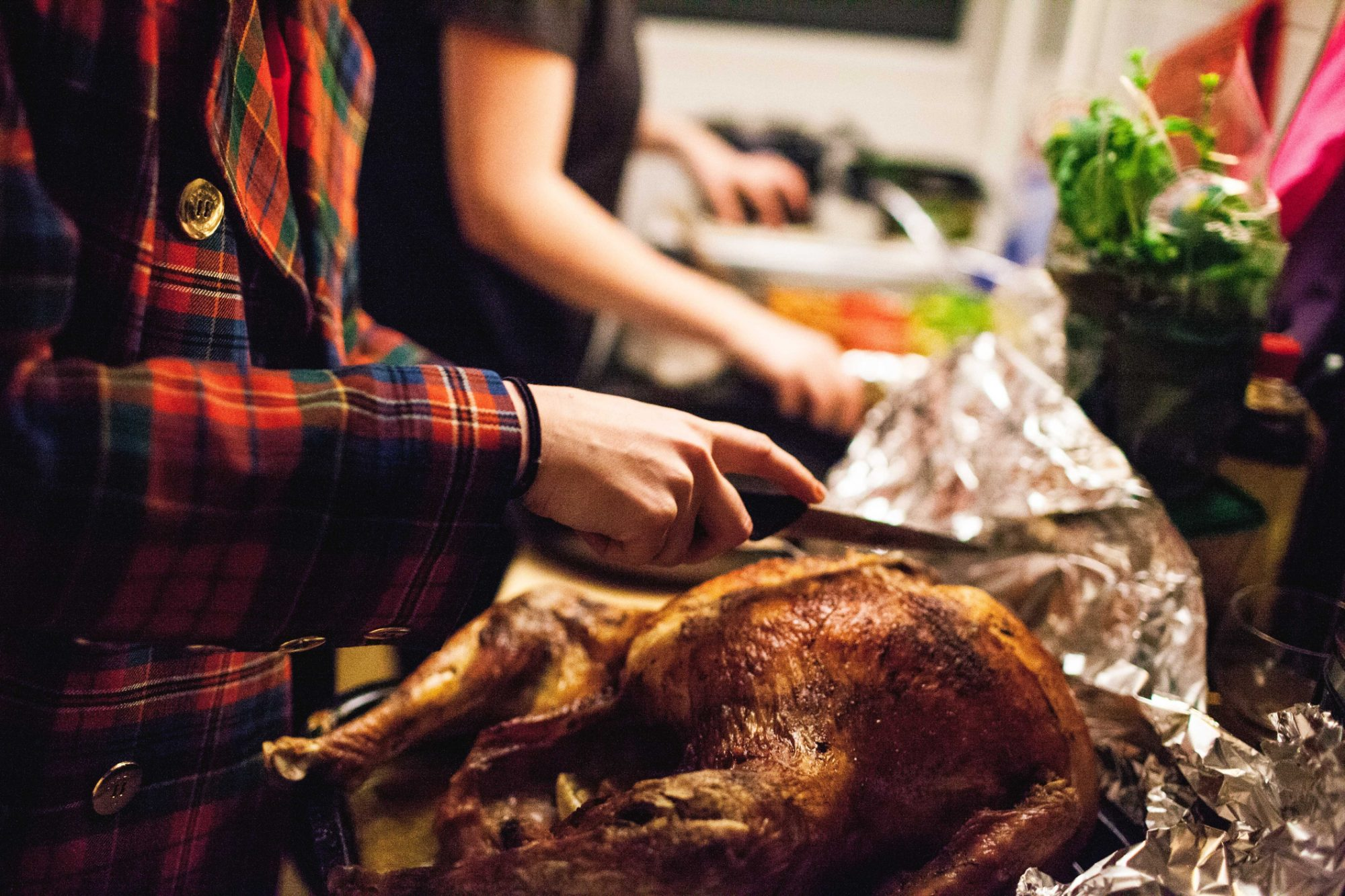 Person Holding Kitchen Knife On Thanksgiving Turkey At Home