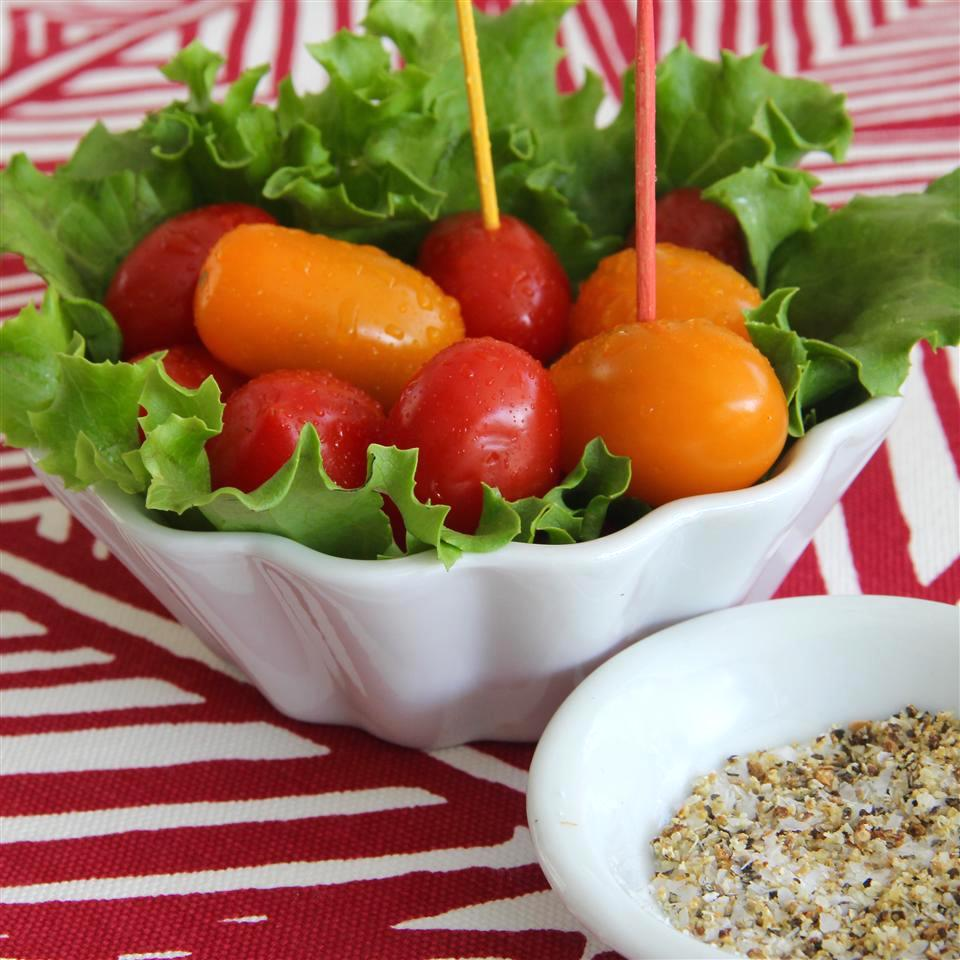 Pepper Vodka Cherry Tomatoes in a white dish with lettuce