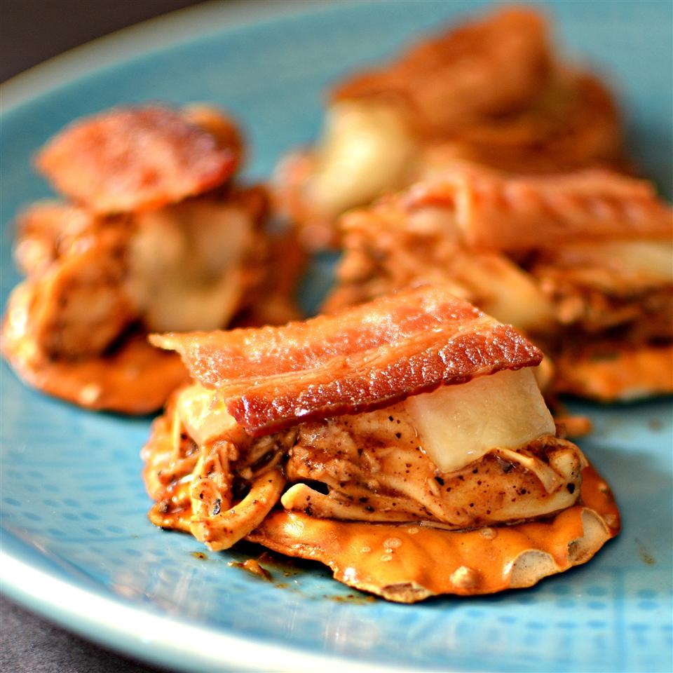 Pretzels with chicken and bacon on top served on blue plate
