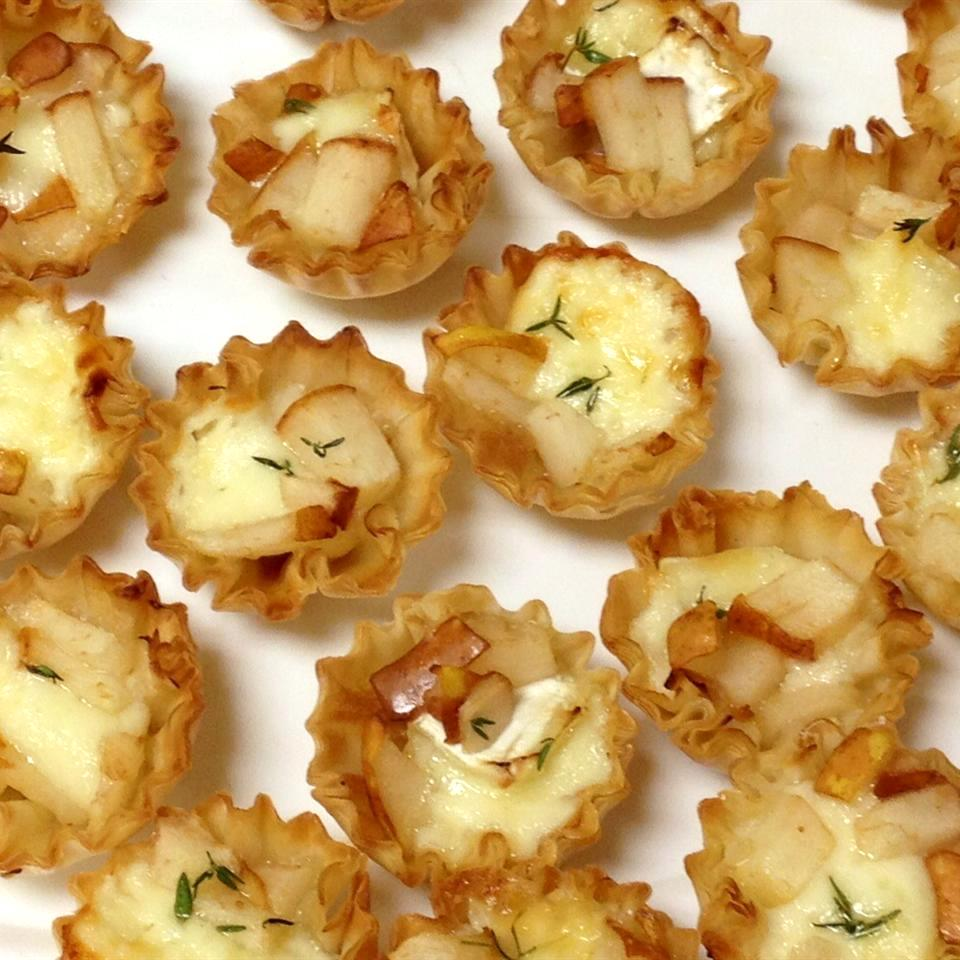 Warm Brie and Pear Tartlets on a white dish