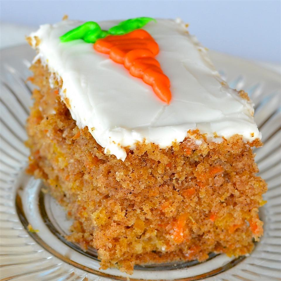 Isaac's Carrot Cake topped with frosting and carrot design