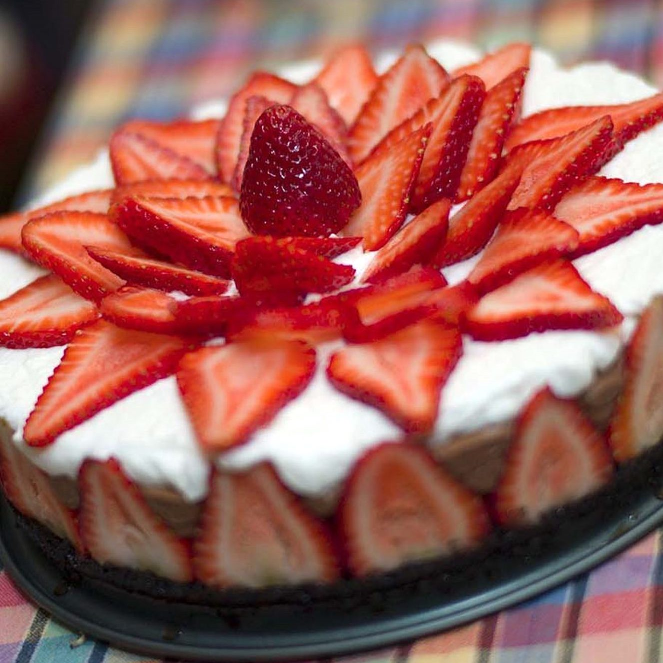 Strawberry Chocolate Mousse Cake topped with strawberries in a flower shape
