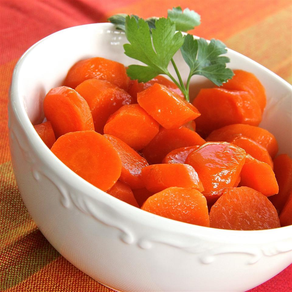 White bowl of carrots with parsley garnish