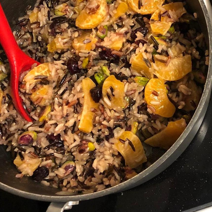 stainless steel pot of Orange Wild Rice with Pistachios and Cranberries
