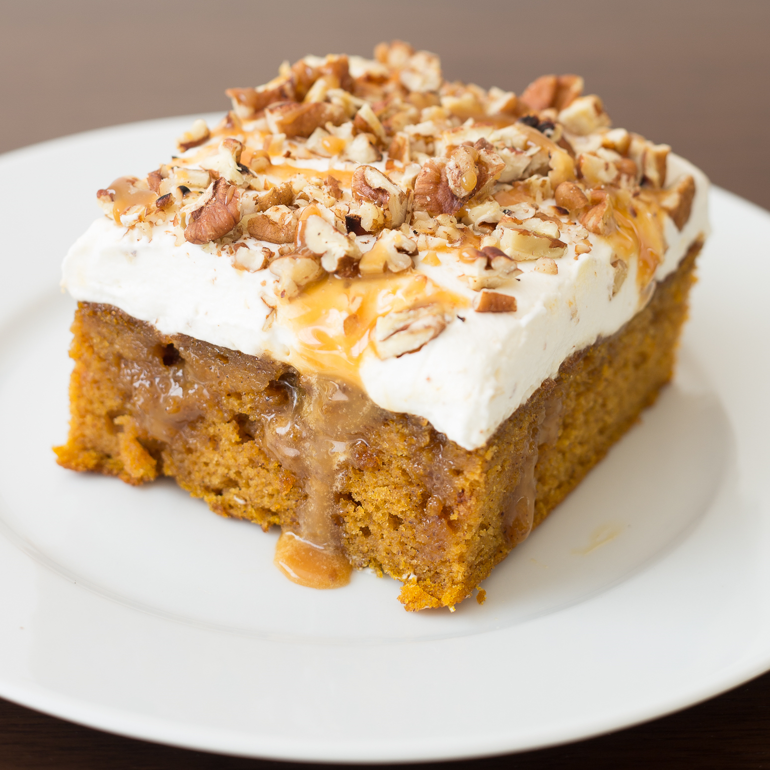 Pumpkin Caramel Bourbon Poke Cake on a white plate
