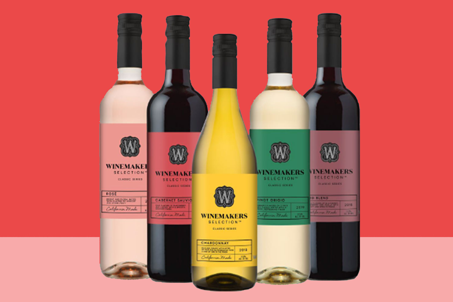 five bottles of wine with a two-toned background