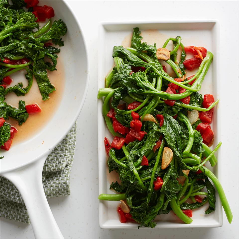 Broccoli Rabe with Roasted Peppers in a white pan and white dish