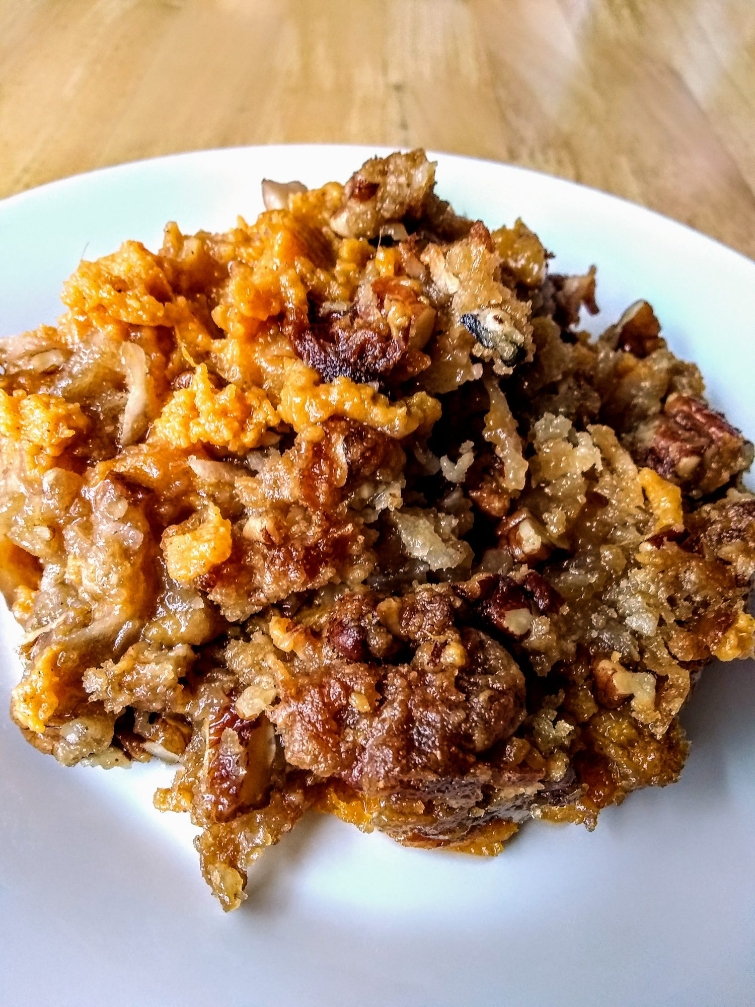 Sweet Potato Streusel Casserole with Coconut on white plate