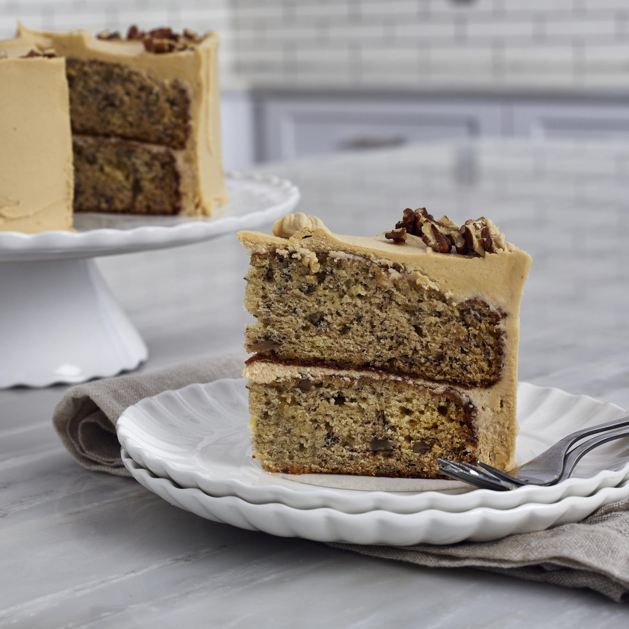 Close-up on slice of banana cake with caramel frosting