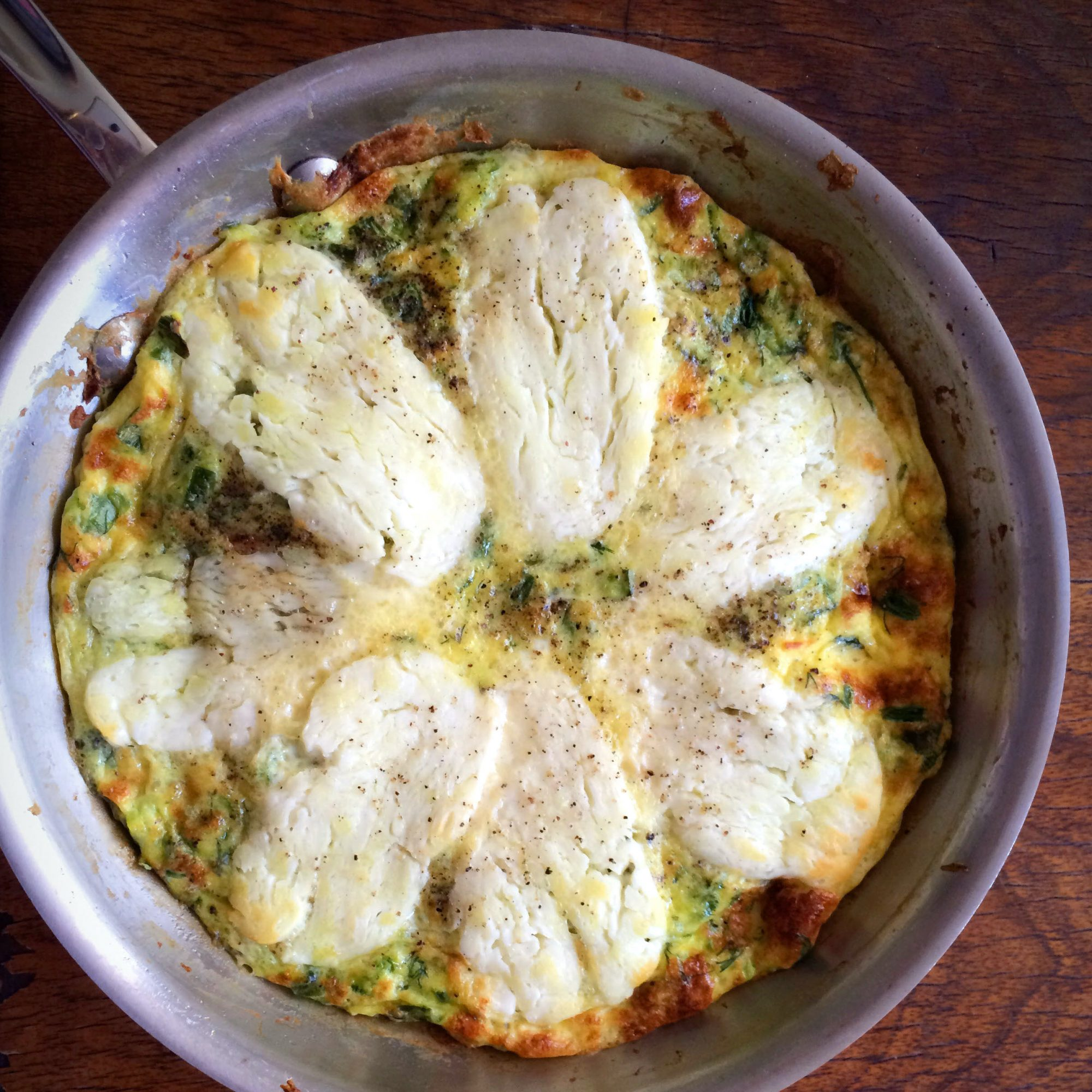 Halloumi and Zucchini Frittata in a stainless steel pan