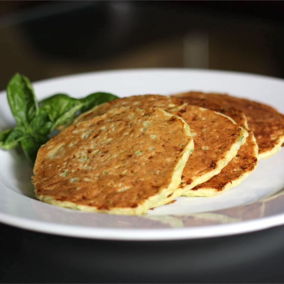 Zucchini Cheddar Pancakes on a white plate