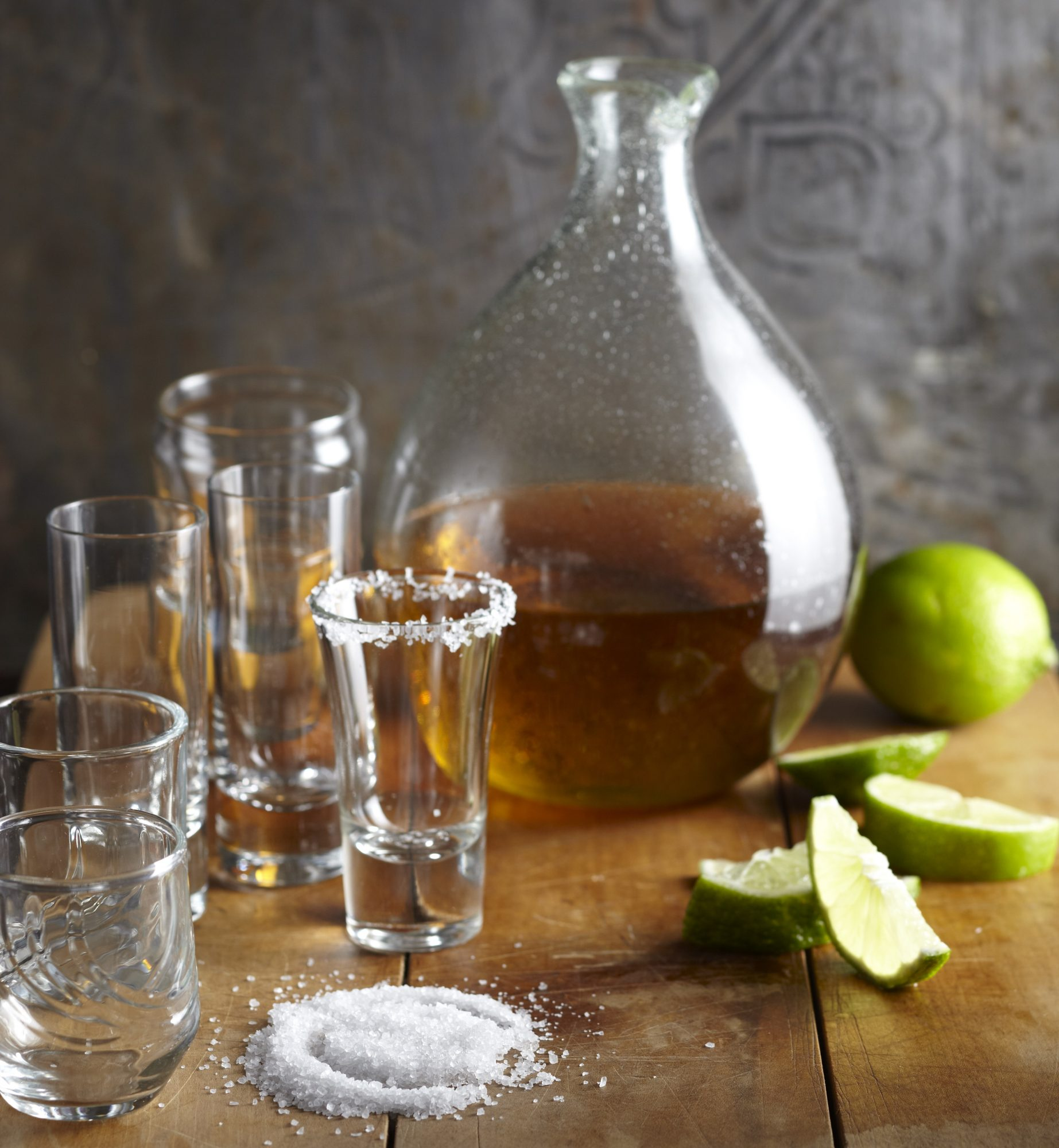 Tequila shots with limes and salt