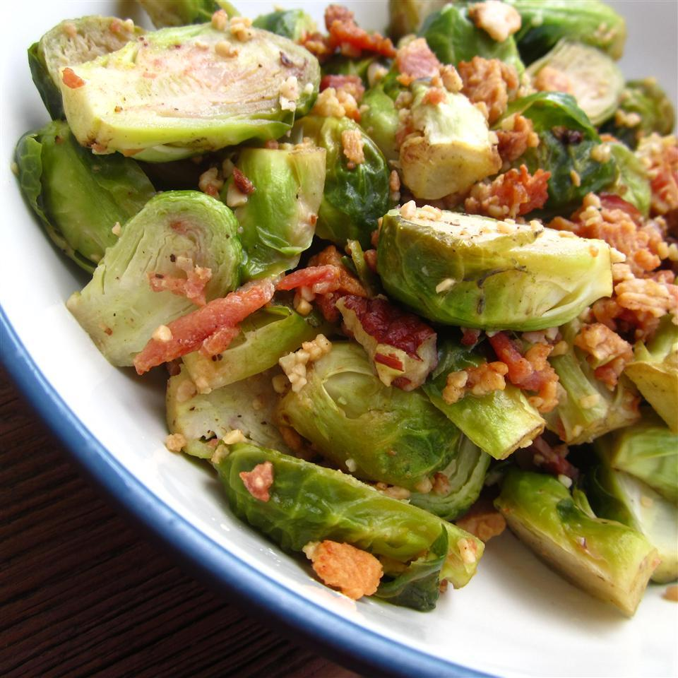 Roasted Brussels Sprouts with Pecans in a white bowl