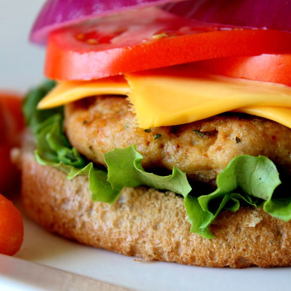 Turkey Meatloaf Burgers with cherry tomatoes on the side