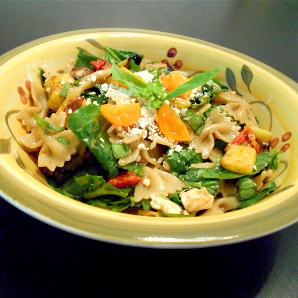 Greek Pasta Salad with Roasted Vegetables and Feta in green floral bowl