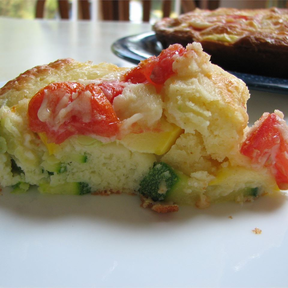 Slice of zucchini pie with tomatoes