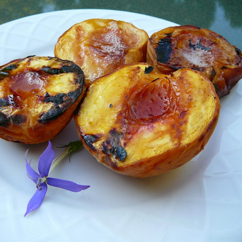 4 Sweet Grilled Peaches on a white plate