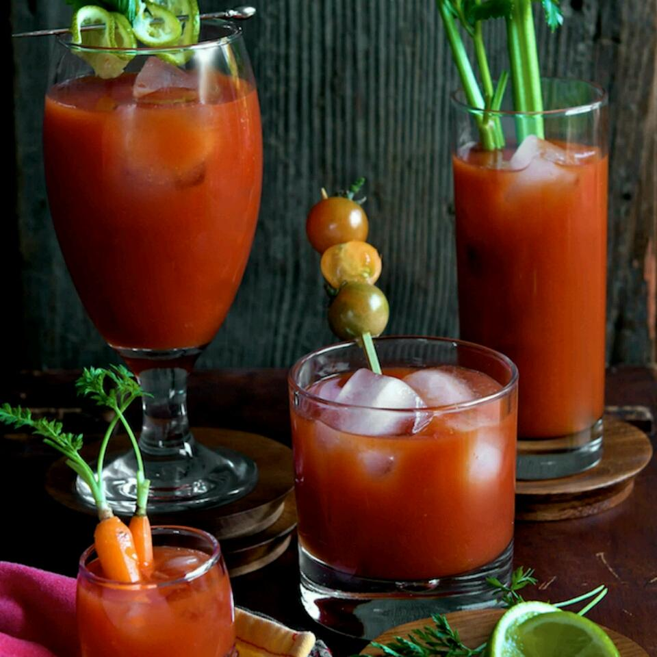 several glasses of Bloody Mary Mix with garnishes